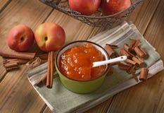 Homemade peach jam with fruit around Stock Images