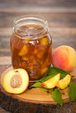 Homemade peach jam in the jar Royalty Free Stock Photography