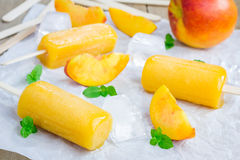 Homemade peach popsicles Stock Photo