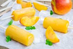 Homemade peach popsicles Stock Photo