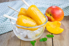 Homemade peach popsicles Stock Images