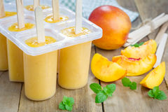 Homemade peach popsicles Royalty Free Stock Image