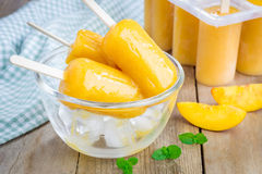 Homemade peach popsicles Stock Photos