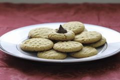 Homemade peanut butter and chocolate drop cookies. Fresh baked cookies. close up Three types of cookies. White plates on table with red tablecloth royalty free stock image