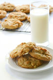 Homemade peanut butter cookies. With glass of milk and cookies cooling on rack in background Stock Images