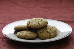 Homemade peanut butter cookies on white plate. Fresh baked cookies. close up showing texture. Plate on table with red tablecloth stock photo