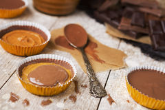 Homemade peanut butter cups on a rustic table royalty free stock image