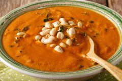 Homemade peanut cream soup close-up. horizontal stock photos