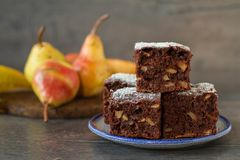Chocolate cake with pears in rustic style. Homemade pear and chocolate cake in rustic decor Royalty Free Stock Photos