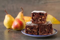 Chocolate cake with pears in rustic style. Homemade pear and chocolate cake in rustic decor Royalty Free Stock Photography