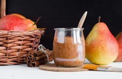 Homemade pear and cinnamon mask in a glass jar. Diy cosmetics Royalty Free Stock Images
