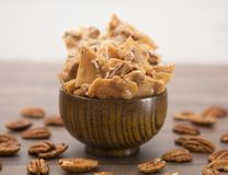 Peanut Brittle on a Wooden Table. Homemade Pecan Brittle on a Wooden Table stock images