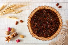 Pecan pie, above view table scene over white wood stock images