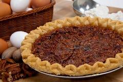 Homemade pecan pie with ingredients Stock Photos