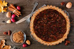 Pecan pie, top view table scene over wood stock photos