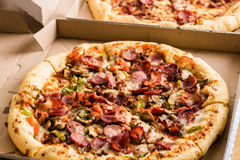 Homemade pepperoni pizza in carton box Royalty Free Stock Photography