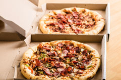Homemade pepperoni pizza in carton box Royalty Free Stock Image
