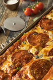 Homemade Pepperoni Sicilian Pan Pizza. Ready to Eat royalty free stock image