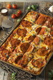 Homemade Pepperoni Sicilian Pan Pizza. Ready to Eat royalty free stock images