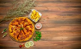 Homemade pepporoni pizza with the ingredients stock image