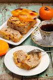 Homemade persimmon cake with fresh persimmons and black tea Royalty Free Stock Photo