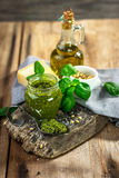 Homemade Pesto alla Genovese. On wooden background Royalty Free Stock Photos