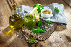 Homemade Pesto alla Genovese. On wooden background Stock Photos