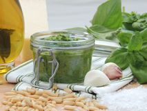 Homemade pesto genovese in a glass jar royalty free stock photos