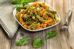Homemade pesto with pasta on rustic wooden table Stock Photography