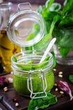 Homemade pesto sauce fresh basil, pine nuts and garlic. On wooden background. Italian food Royalty Free Stock Image