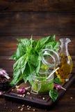 Homemade pesto sauce fresh basil, pine nuts and garlic. On wooden background. Italian food Stock Image