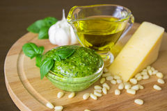 Homemade pesto sauce with ingredients over old table. Front view Stock Photo