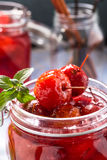 Homemade pickled crabapples in syrup Stock Photos