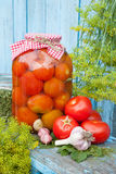 Homemade pickled tomatoes in glass jar. Fresh vegetables, dill a Stock Photos