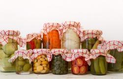 Homemade pickled vegetables jars prepared with vinegar and salt stock image