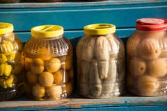Homemade  pickles variety preserving jars. Homemade  marinated pickles variety preserving jars Royalty Free Stock Images