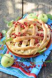 Homemade pie with apple and red cherry Royalty Free Stock Photos