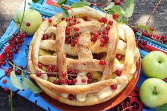 Homemade pie with apple and red cherry Royalty Free Stock Photography