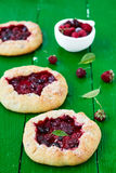 Homemade pie galette with berries. Strawberrie, raspberrie and black currant Stock Photos