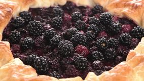 Homemade pie. Closeup on blackberries stock footage