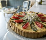 Homemade pie tart with tomatoes, asparagus and royalty free stock photos