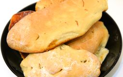 Homemade pies closeup. Baked homemade pies with filling on black plate Royalty Free Stock Photos