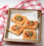 Homemade pies of puff pastry with tomato Royalty Free Stock Image