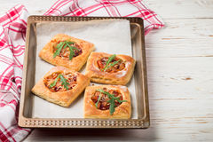Homemade pies of puff pastry with tomato Stock Photos