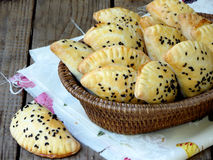 Homemade pies sprinkled with black sesame seeds in a basket Royalty Free Stock Images
