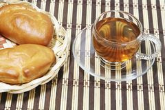 Homemade pies with stuffing  and tea in a cup for breakfast. Still life Stock Images