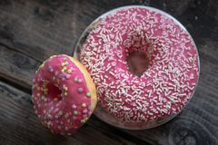 Homemade pink glazed donuts stock image