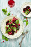 Homemade pink ravioli tortellini with goat cheese decorated beet leaves, beetroot slices and cranberry Royalty Free Stock Photos