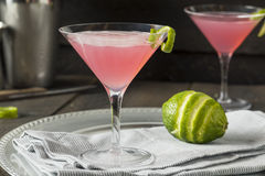 Homemade Pink Vodka Cosmopolitan Drink. With a Lime Garnish royalty free stock images