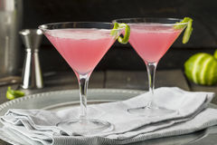 Homemade Pink Vodka Cosmopolitan Drink. With a Lime Garnish stock image